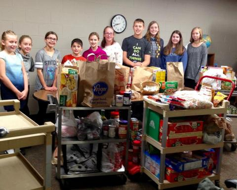 "Student Council hosted a ""Packing the Pantry for Pontiac"" breakfast. This event brought in 764 pantry items, plus $45 in cash donations for our sister congregation, St. Paul, to help feed their community in Pontiac."